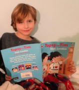 Theo reading children's book on London