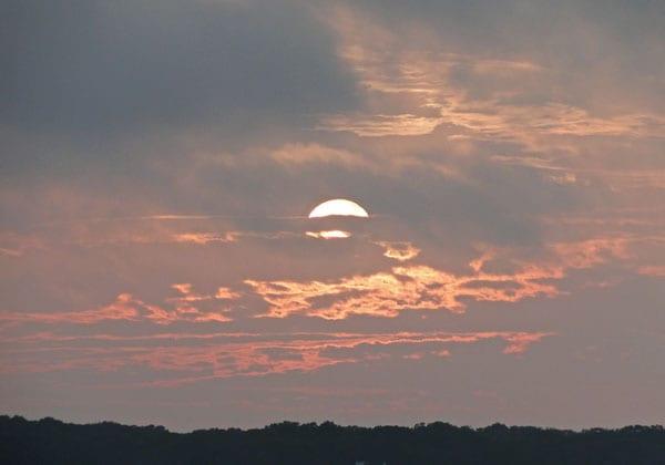 Sun setting clouds