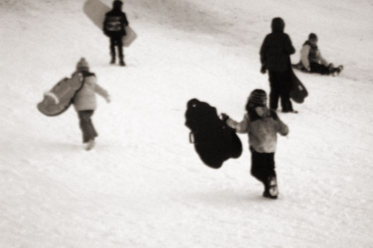 running up hill carrying sleds