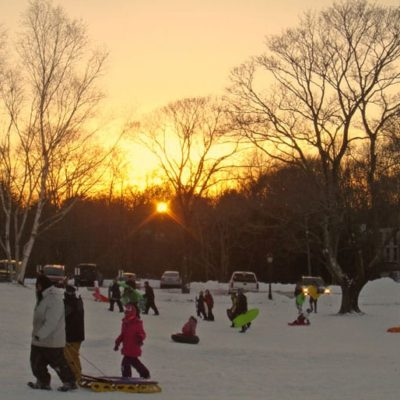 Winter sledding while the sun slides down