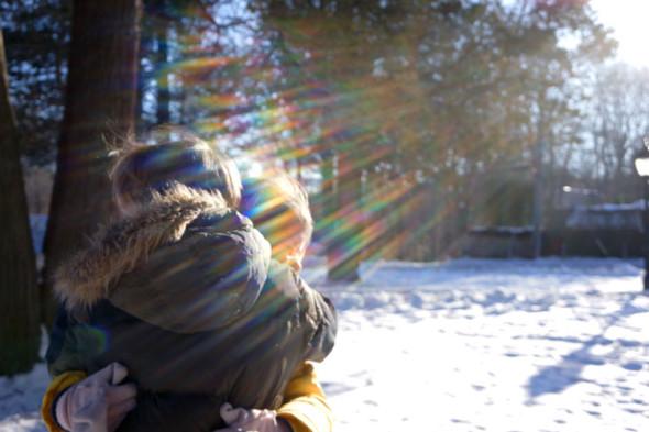 twins hugging sunlight rays