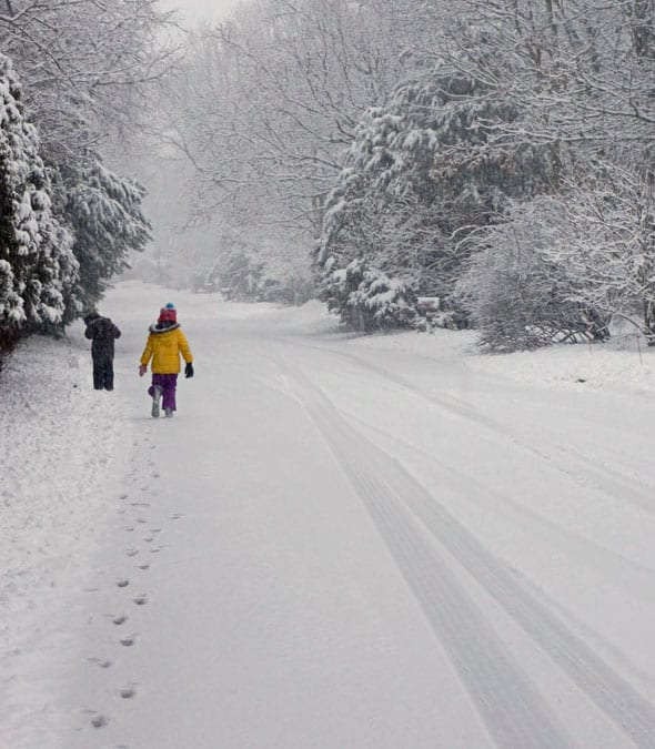 walking snow covered road