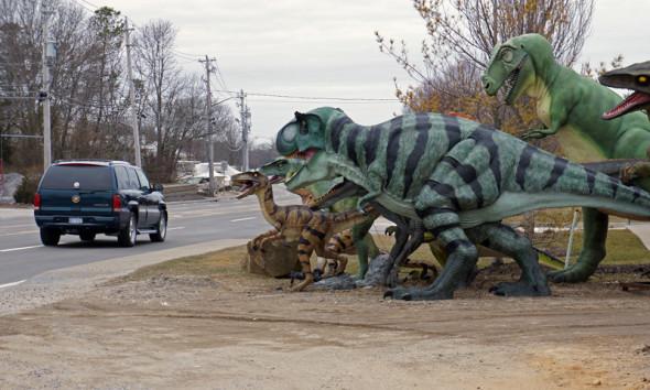 dinosaur and car