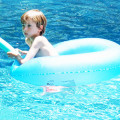 Sitting in blue ring in blue water in pool