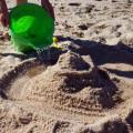 Pouring water sandcastle moat
