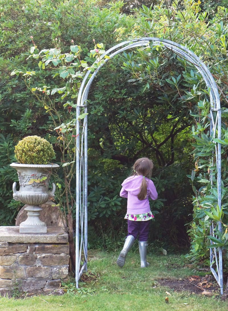 rose covered arch and urn