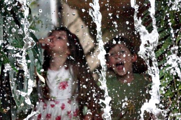 Luce Theo behind Waterfall