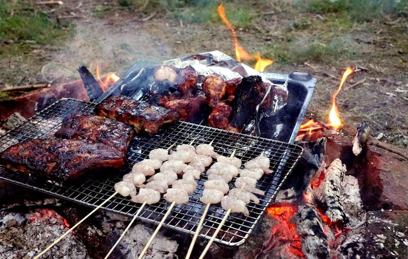 ribs chicken shrimp cooking on campfire