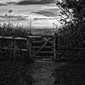 sunset behind gate