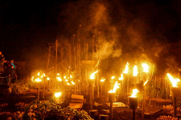 garden burning torches Wakehurst