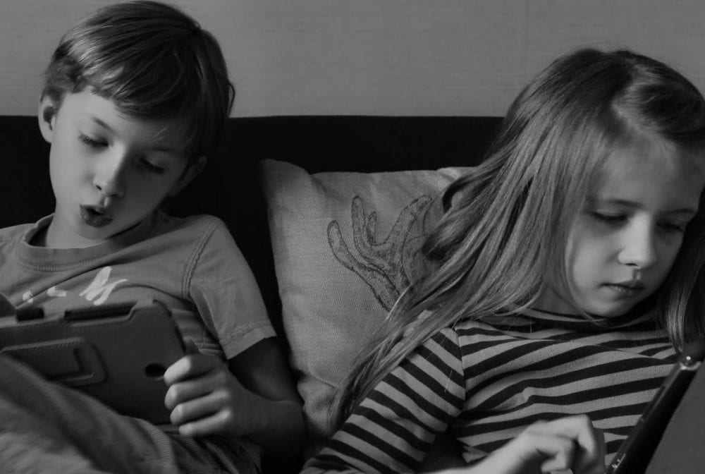 Luce and Theo with tablets 1
