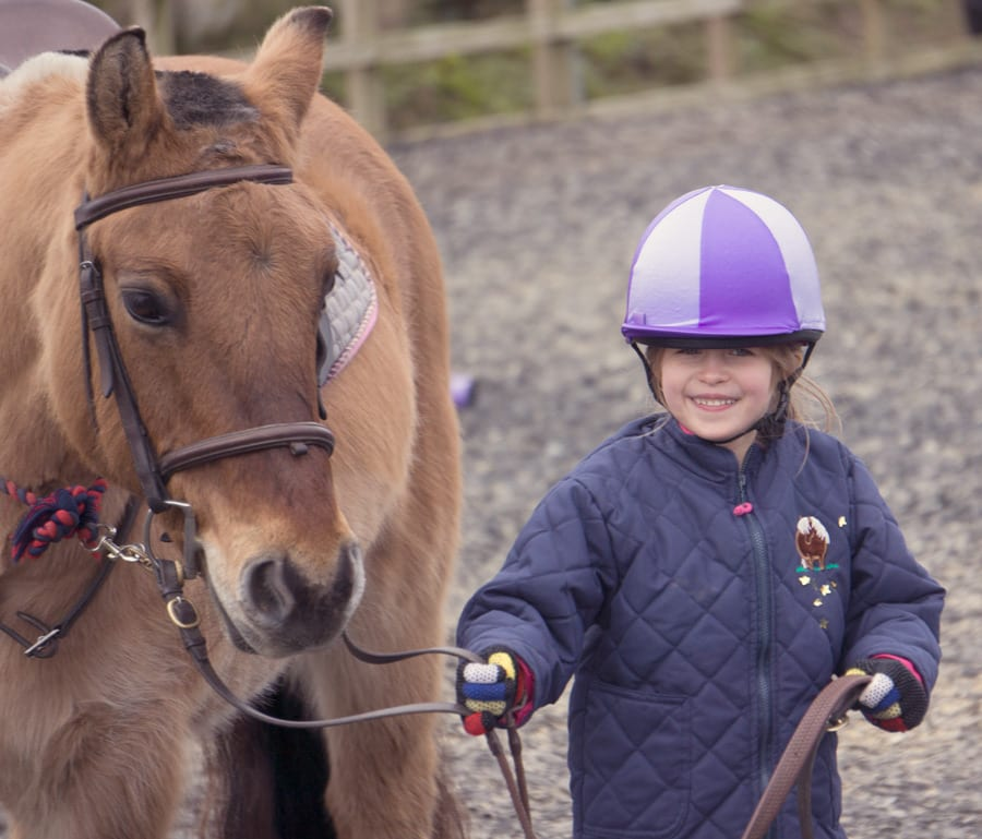 Luce smiling with horse