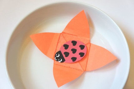 Floating paper flower with ladybug