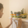 Luce looking at row of mini cactii