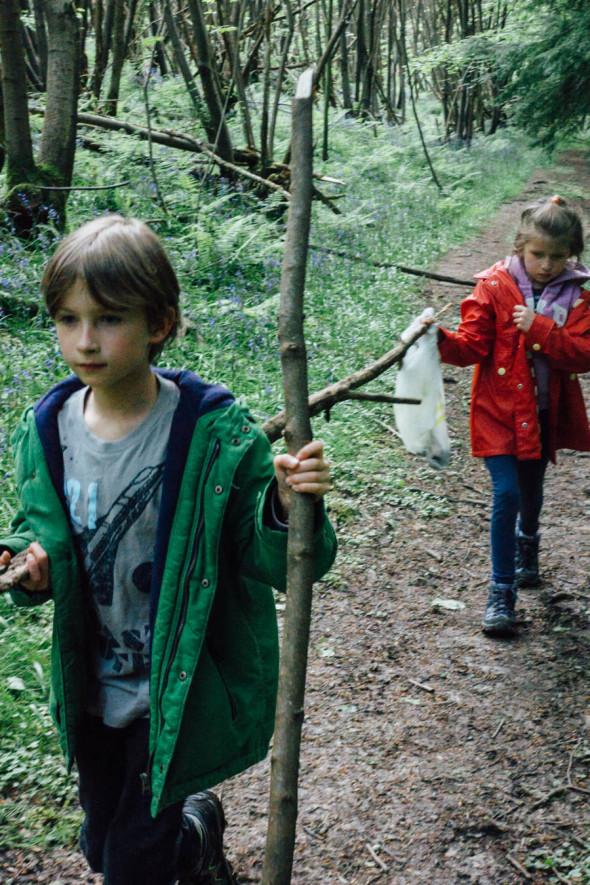 Carrying long sticks on woodlands scavenger hunt