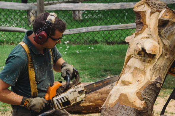 Chainsaw sculptor at village fair