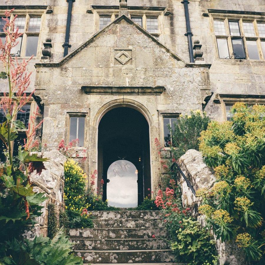 Gravetye manor side door with reflection