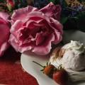 Meringue nest with strawberry ice cream and vanilla cream
