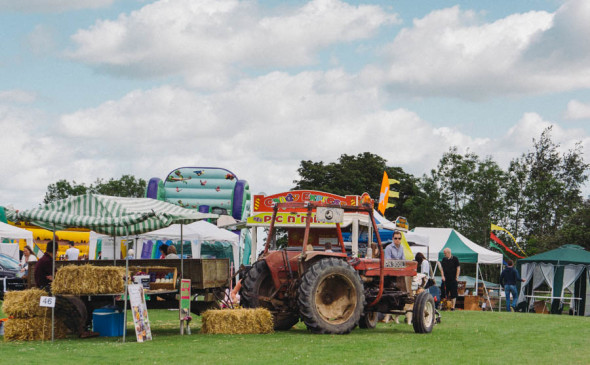 Tractor and stands village fair