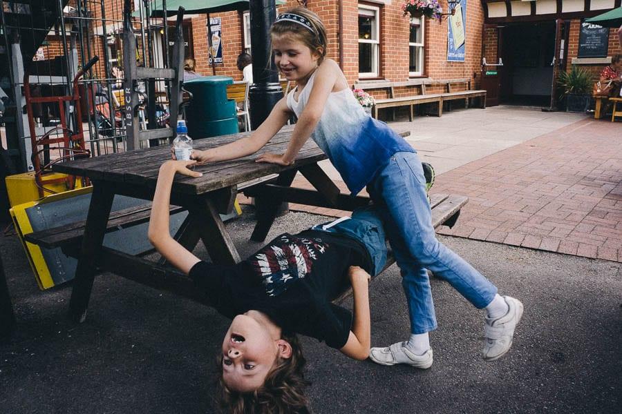 Luce and Theo fooling around on platform