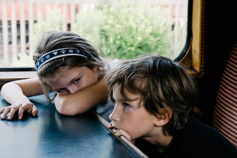 Luce and Theo leaning on train table
