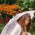 Luce with umbrella in Gravety Garden