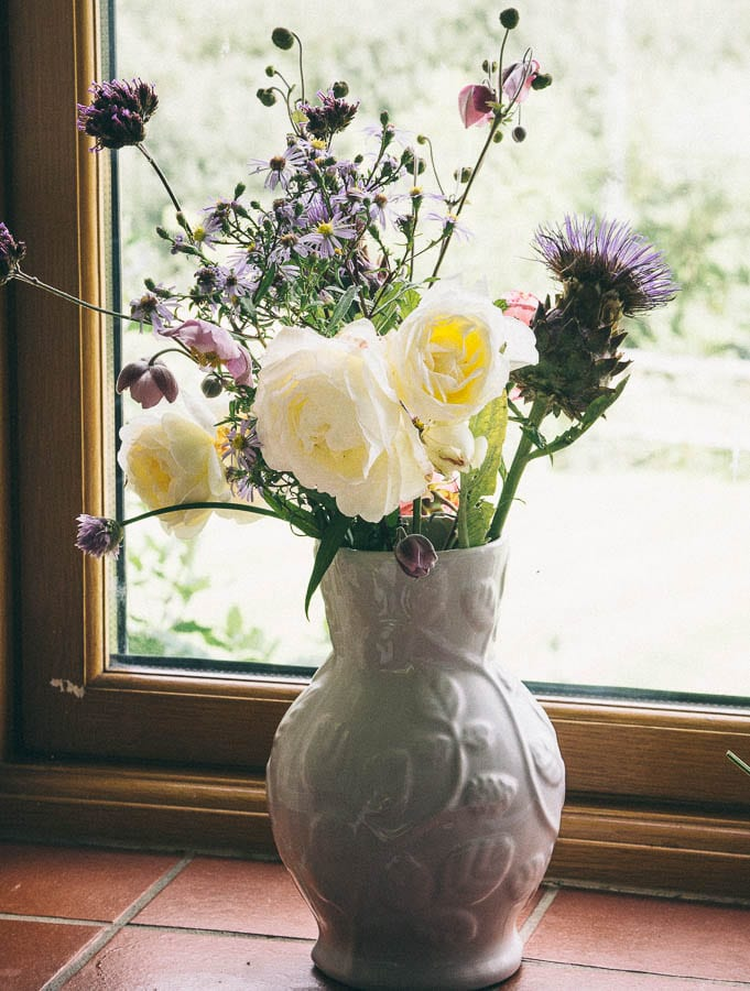 Vase of flowers in window