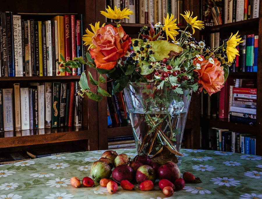 Autumn flowers in vase and fruit