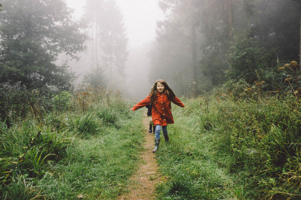 Running on wood path in mist