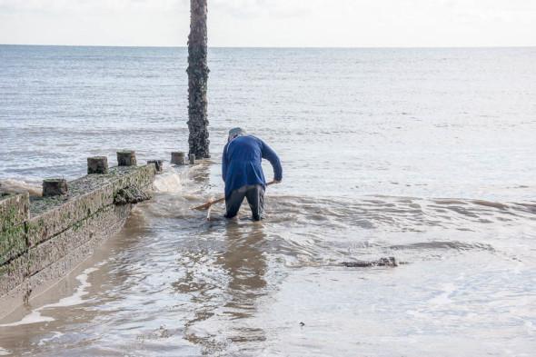Shrimping at Kingsdown Kent dragging net in water