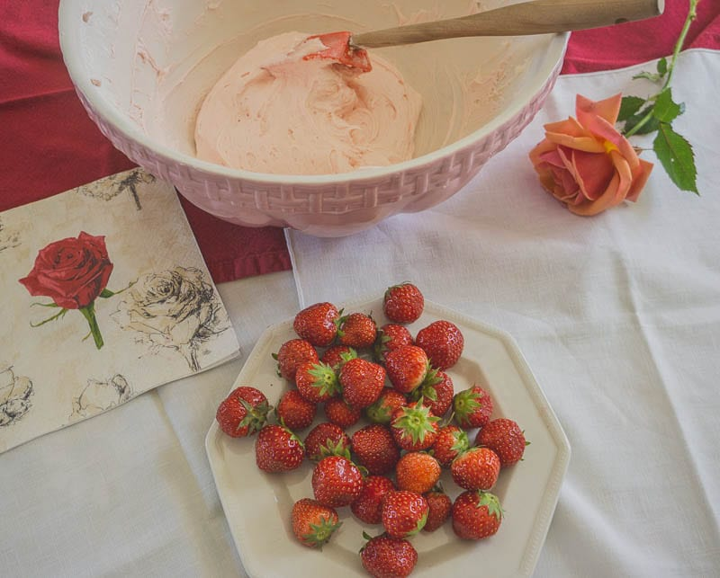 Strawberries and rose buttercream frosting