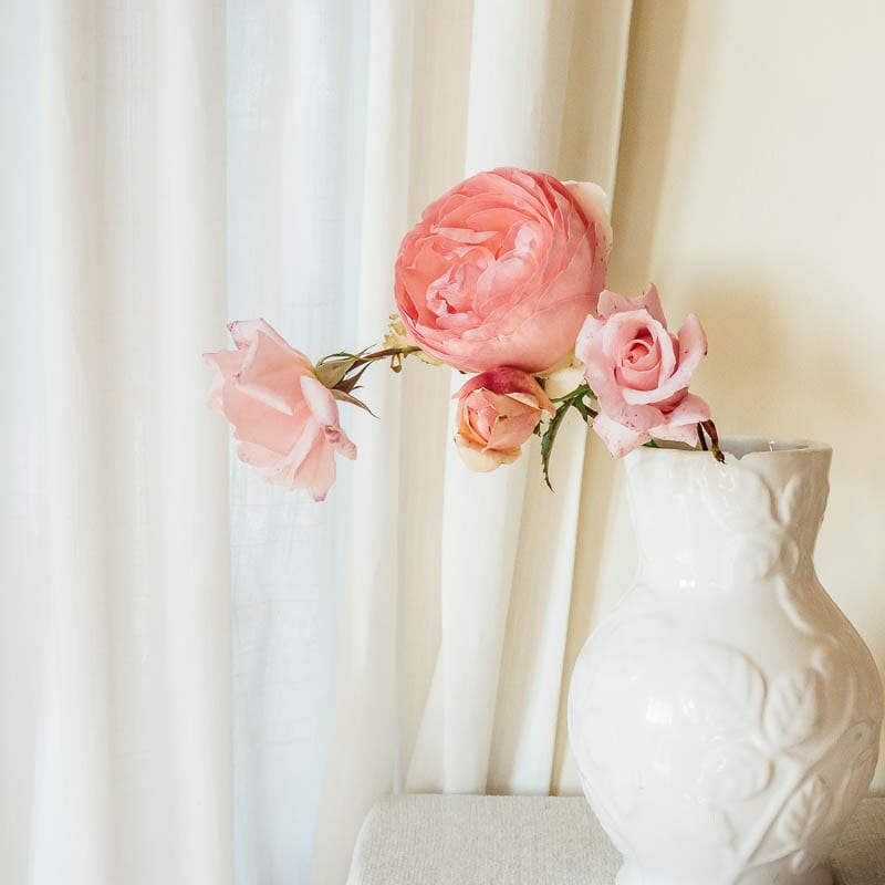 White vase with pink roses