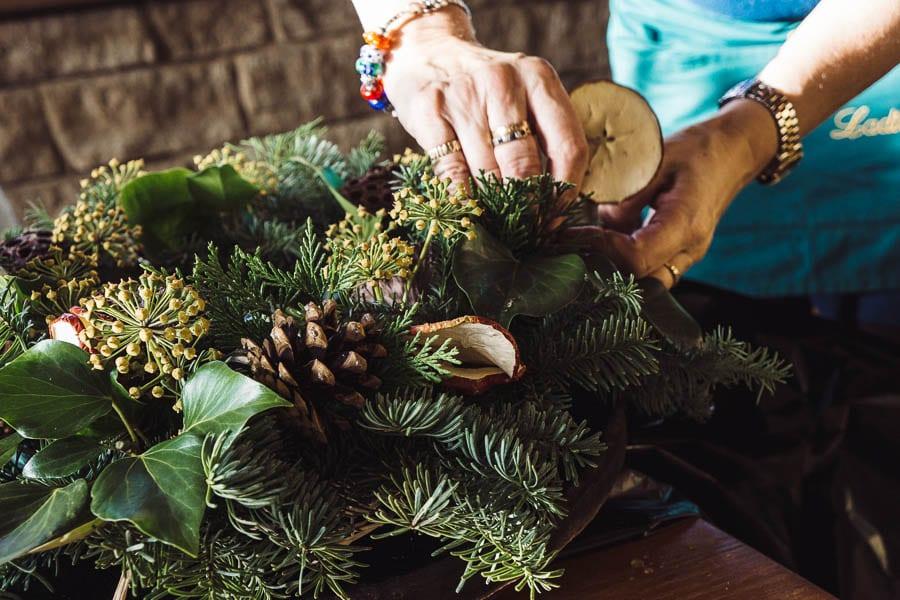 Christmas wreath adding dried apples