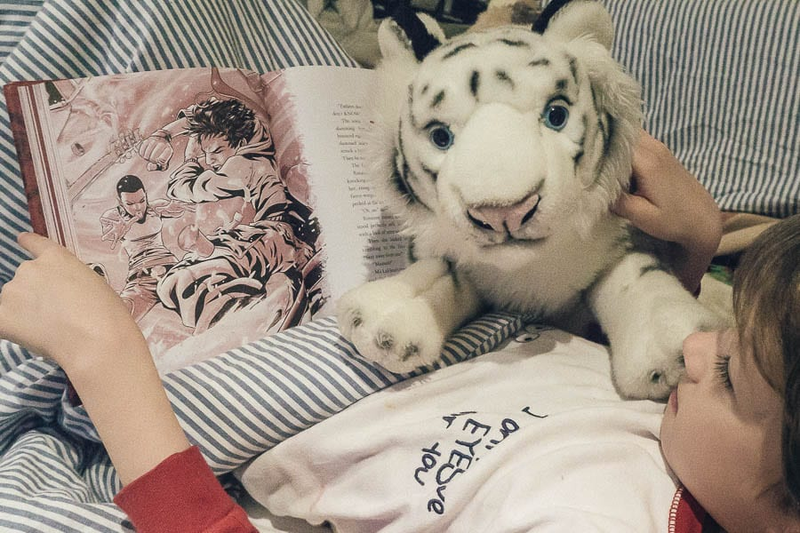 Zodiac reading in bed with tiger