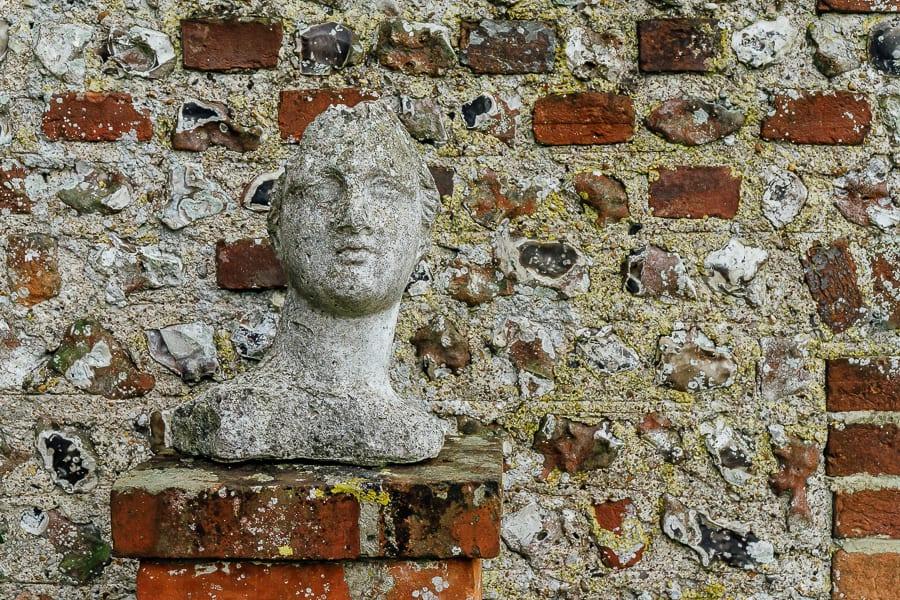 Charleston garden bust against wall