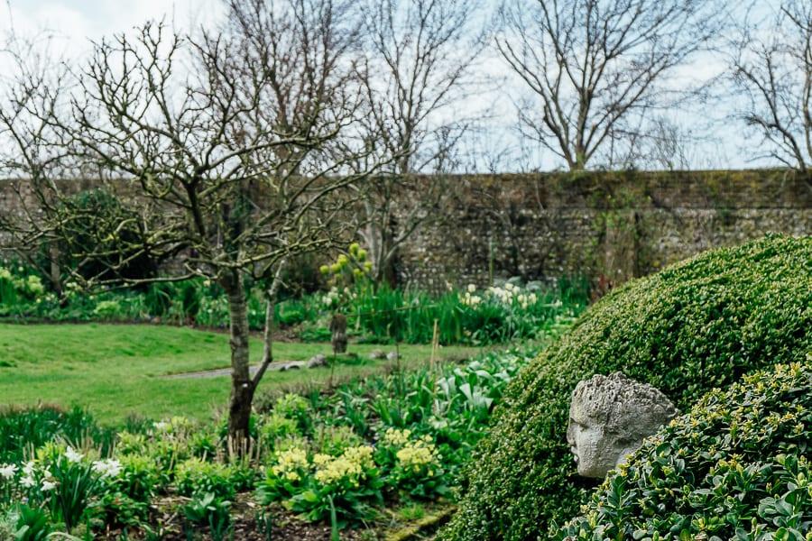 Charleston walled garden bust in hedge