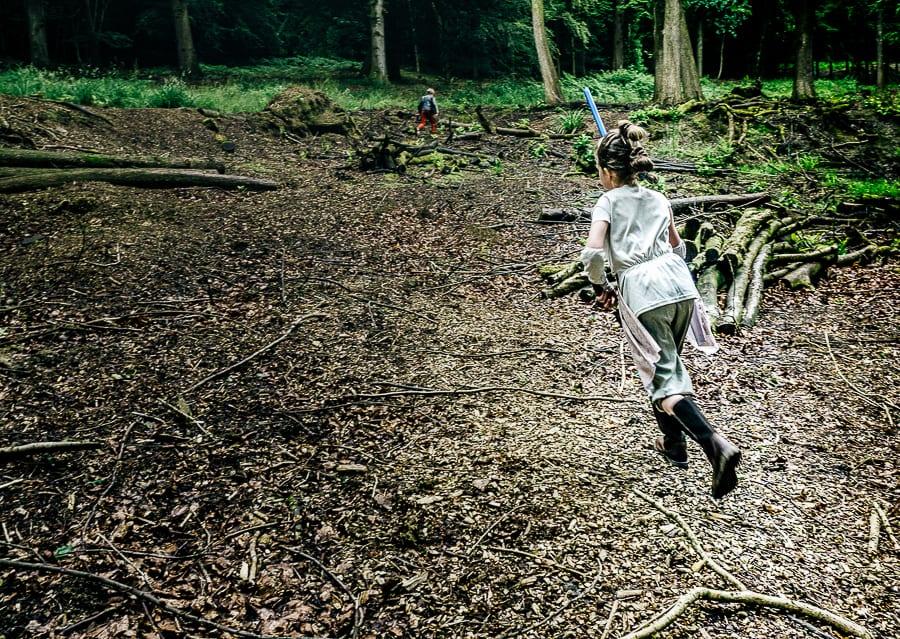 Lightsaber battle Rey running woods