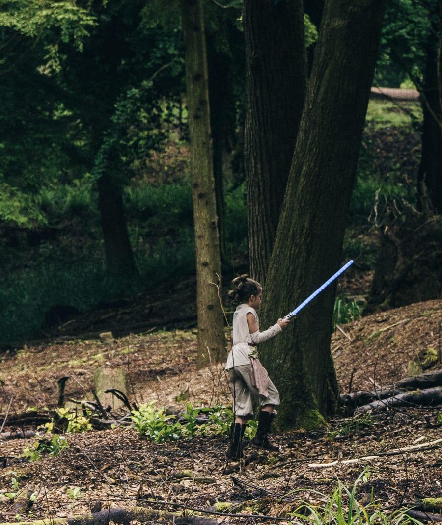 Lightsaber battle in woods Rey