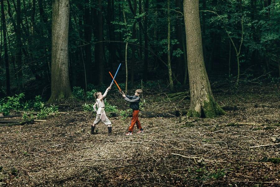 Lightsaber battle in woods kids clash