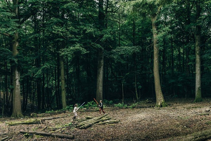 Lightsaber battle in woods kids