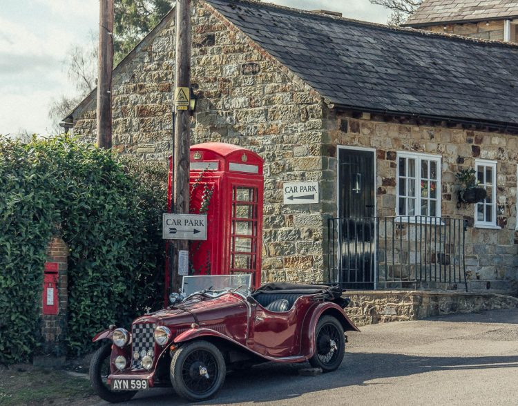 british pub coah and horses vintage car